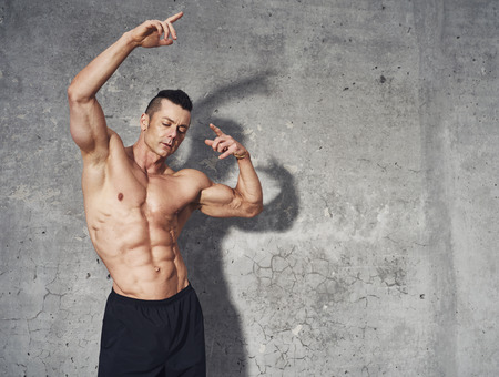 crossfit: Fitness model posing showing abdominal muscles, fitness concept professionel male fitness model, copy space Stock Photo