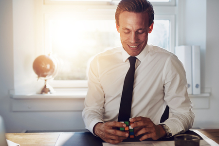 paralegal: Successful executive business man sitting at his office getting ideas Stock Photo