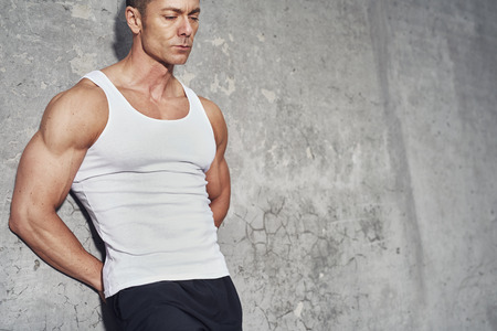 restitution: Close up fitness concept portrait of white man, fit and healthy, white tanktop, fitness concept