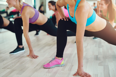 athletics: fitness, sport, training, gym and lifestyle concept - close up of people exercising in the gym Stock Photo