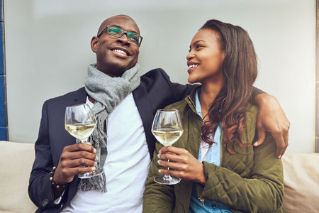 good time: Black couple having a good time drinking a glass of wine