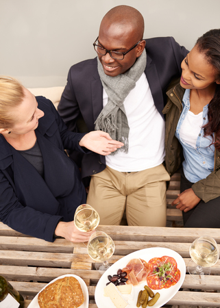 threesome: Group of friends having dinner outside, multi ethnic group