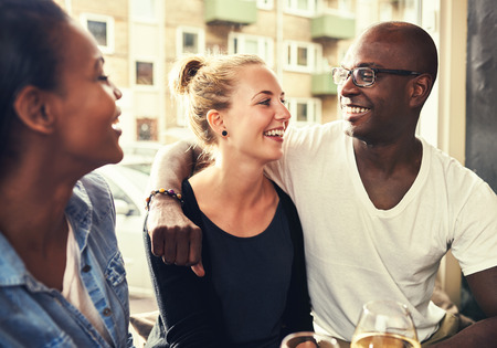 camaraderie: Multi ethnic couple smiling at each other