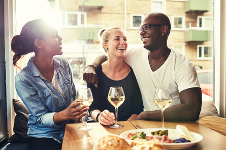 multi racial: Multi racial couple out dining with a afro american female friend