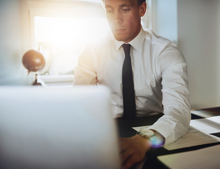 paralegal: close up of executive business man with laptop working concentrated