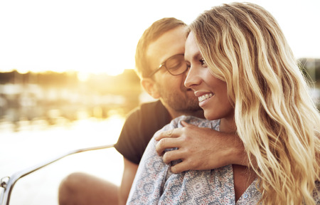 Man Kissing Woman while Woman Smiling Gently Stock Photo
