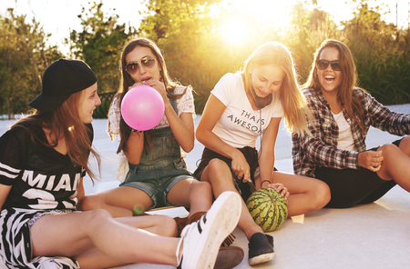 summer fruits: Group of girls having fun, skateboards and sunglasses