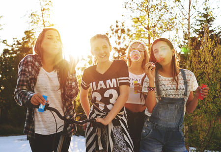 Teenagers having fun while posing for the camera outside