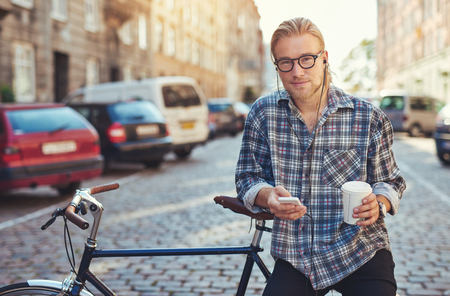 urban people: Man living the city lifestyle enjoying life with a cup of coffee Stock Photo