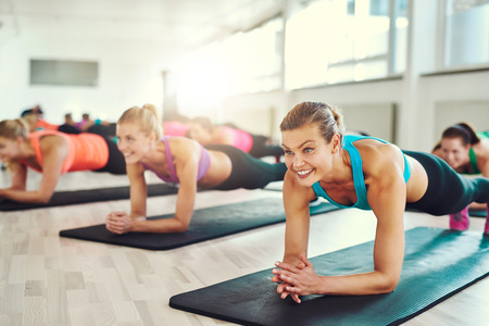 Young women working out together on rugs Stockfoto