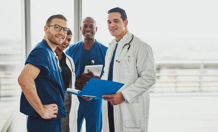 doctors: Doctor leading a medical team at hospital, surgeons and medical doctors Stock Photo