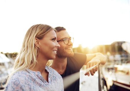 enjoying life: Husband and Wife Enjoying Life while Sitting on a Boat
