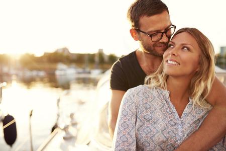 enjoying life: Couple Sitting on Their Boat Enjoying Life While In Love