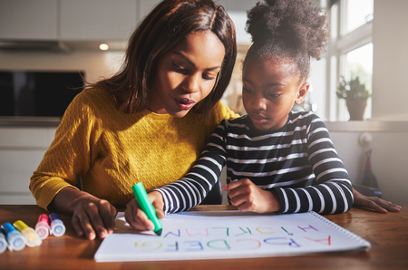 mum and child: Black mother and child doing homework, learning the alphabet