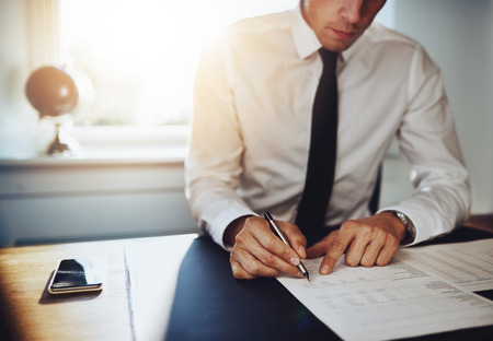 business concept: Business man or accountant lawyer working on documents, close up business concept