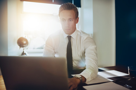 paralegal: Young business man working on laptop at his office Stock Photo