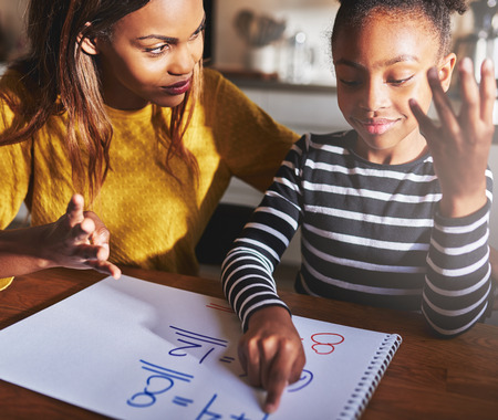 Mother learning child to calculate, black mother and daughter Reklamní fotografie - 63176103