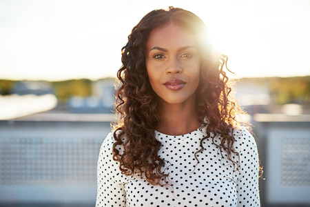 attractive woman: Portrait of an attractive smiling black woman Stock Photo