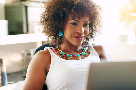 Portrait of attractive curly woman in beautiful necklace working in office. Copyspace Stock Photo