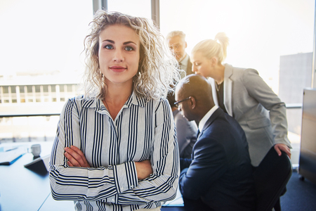 Business woman standing in front of team, Team of mixed entrepreneurs Stock Photo