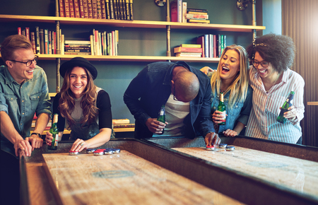 Group of friends having fun playing a game. Mixed races as friends Stock Photo