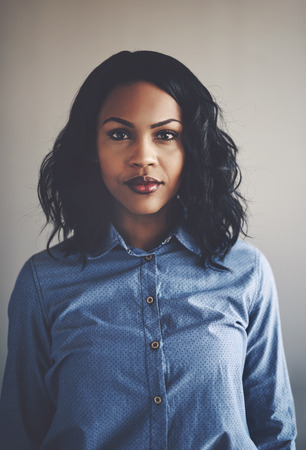 Portrait of an attractive young African businesswoman standing confidently alone in an office