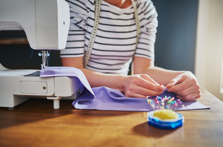 Closeup of hands sewing on a machine