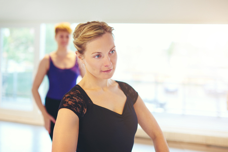 Adult woman standing and dancing in group dancing ballet. Reklamní fotografie