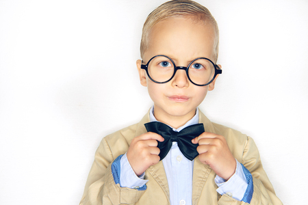 d569070f5b37 Cute little blonde boy dressed like a professor wearing a suit and glasses  and adjusting a
