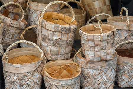 Wicker basket made of birch bark. National Slavic crafts. Handmade in a rustic style. A basket for berries, mushrooms, fruits, vegetables, for household Stock Photo