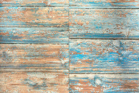 abstract paintings: The old wooden background painted with blue paint. Plank wood texture. For design. The vertical pattern has a lot of space for text.