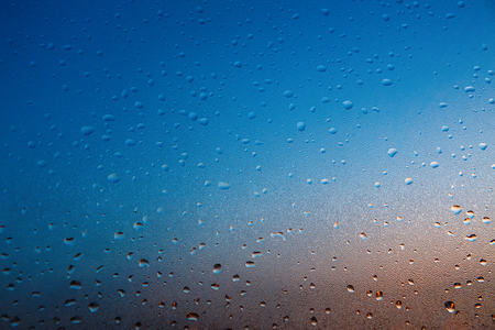 Background with drops on the glass, tinted a deep blue - orange. Diagonal gradient. Plenty of space for text. For your design. Stock fotó