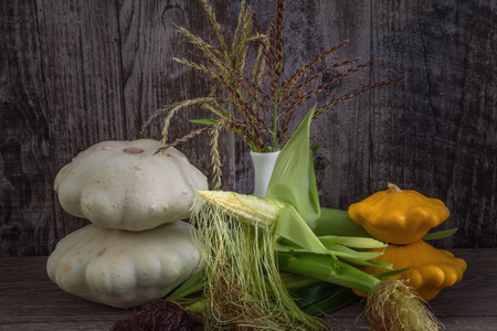 Mountain of different vegetables lying on dark grey wooden table. The gifts of autumn. Freshly picked autumn vegetables. Studio light.