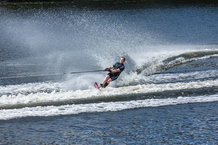Novopolotsk, Belarus - June 10, 2017: the annual international tournament on water skiing, held on lake Lyuhovo. Athlete water-skiing behind a boat, he in the younger age group. The event - the slalom