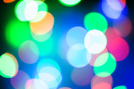 abstract of light at night. Christmas bokeh lights in holiday washed light. Christmas lights. Bokeh lights against a dark background. Stock Photo