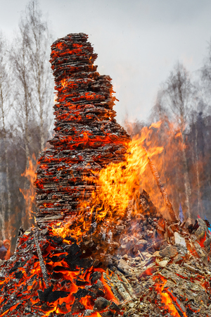 High fire. The fire burned on Shrove Tuesday. The concept of the completion of the winter and onset of spring. Purification. Stock Photo