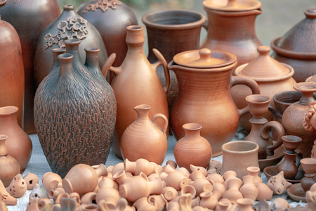 Various ceramic products from clay are presented. There are comfortable and functional items with different shape for food and drink from clay. Outdoor photos.