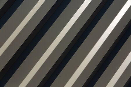 there is a galvanized ribbed painted gray metal profile for fences, roofs, walls. Front view of gray ribbed metal surface on fence or wall for background. gradient light, diagonal arrangement, contrast light Stock fotó
