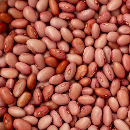 Fresh beans. The view from the top. Food Background. Scattering of grains. Health food. Raw red beans texture for food background top view. Red bean texture background. Selective focus, lens blur.