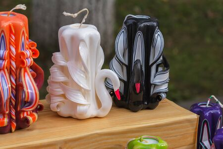 Designer handmade candles in the form of swans. White and black swans are presented in the form of paraffin or wax candles. Stok Fotoğraf