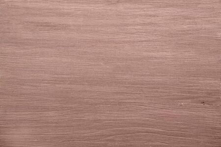 horizontal painted light brown solid smooth wood, background or texture. Natural colored wood texture