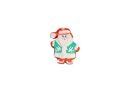 Traditional bright colorful Christmas ginger ice cookies are shaped like Santa Claus and isolated on a white background.