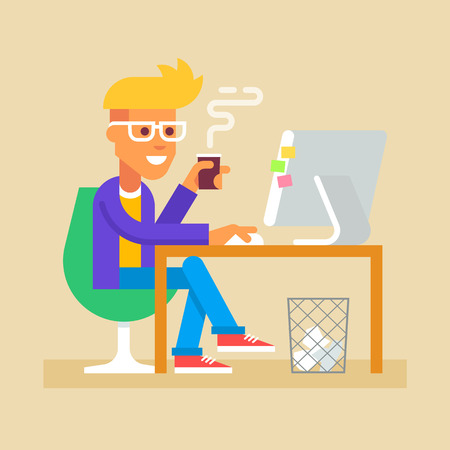 internet surfing: Young man is sitting  at a desk with a computer and drinking coffee. Internet surfing.