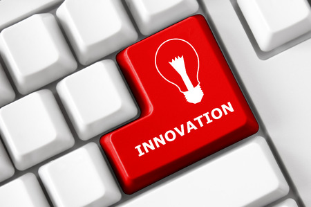 innovation word: Modern keyboard Innovation text and electric lamp symbol. Technology concept