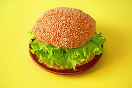 Fresh vegan burger with lettuce and tomato. healthy and vegetarian food.