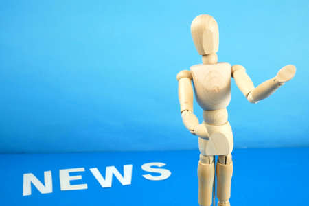 control a marionette by strings on fingers and word news on blue background, concept