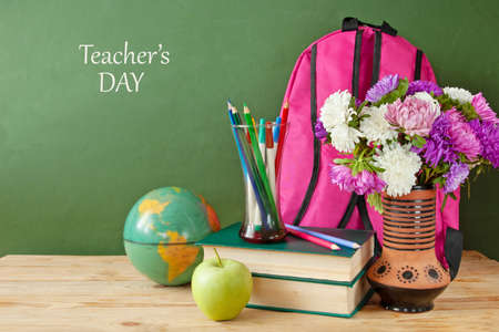 World Teacher's day concept. Flowers bunch, pencils globe and books