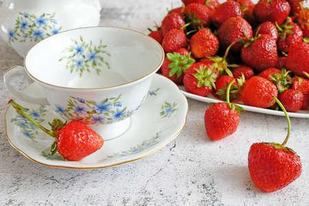 tasty fresh strawberry with milk sour cream or yogurt closeup, dessert with strawberries, closeup
