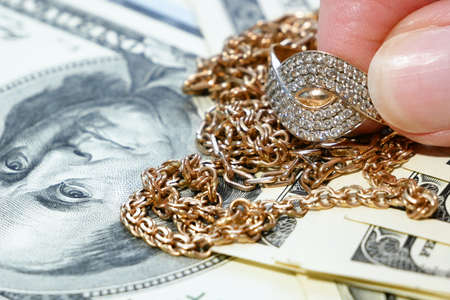 jewelry scrap of gold and silver and money, pawnshop concept, closeup