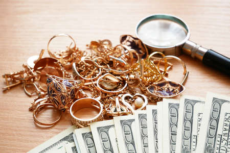 jewelry scrap of gold and silver and money, pawnshop concept